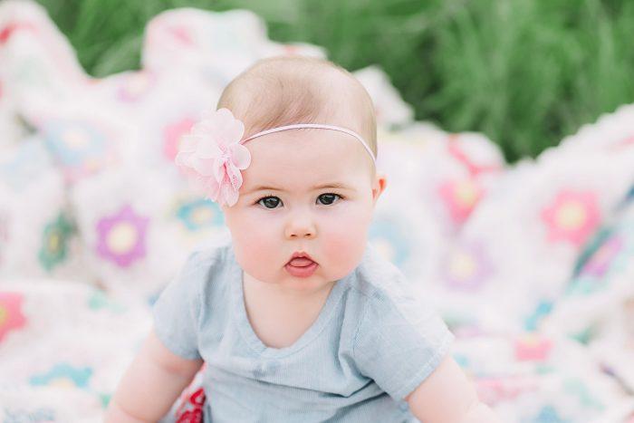 Baby wearing pink headband